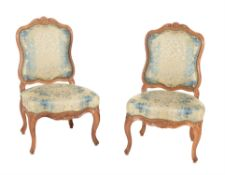 A pair of walnut and upholstered side chairs