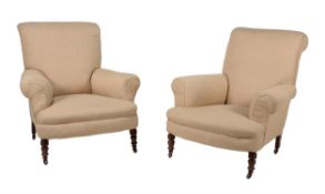 A pair of late Victorian oak and 'oatmeal' upholstered armchairs