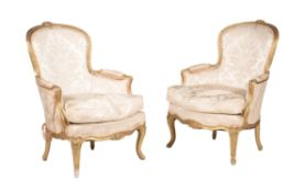 A pair of giltwood upholstered armchairs in Louis XV style