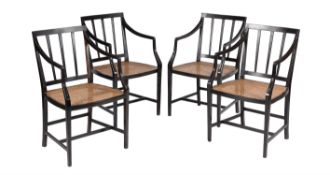 A set of four Sinhalese ebony elbow chairs in George III style