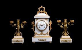 A white marble and ormolu mounted mantel clock