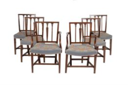 A set of twelve mahogany dining chairs in George III style