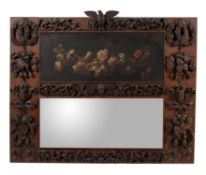 A carved oak wood trumeau wall mirror