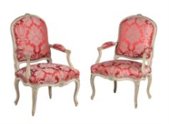 A pair of green painted Louis XV armchairs
