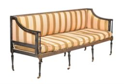 A Regency ebonised, parcel gilt, and upholstered sofa