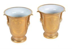A pair of German porcelain crested burnished gilt-ground two-handled flared urns