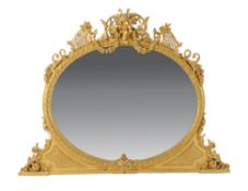 A late Victorian carved giltwood and composition overmantel mirror
