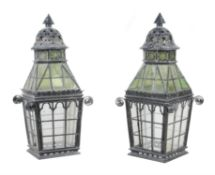 A pair of late Victorian black-painted cast-iron metal and glazed lanterns