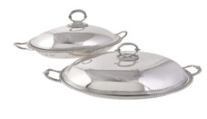 Two similar silver oval graduated vegetable dishes