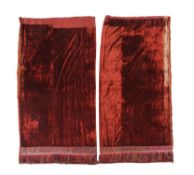 A pair of orange red velvet curtains