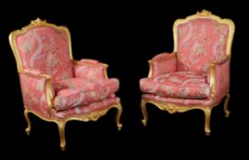 A pair of French giltwood bergeres armchairs in Louis XV style