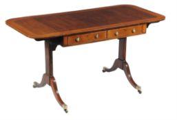 A Regency mahogany and satinwood sofa table