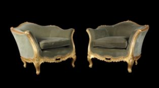 A pair of carved giltwood tub chairs
