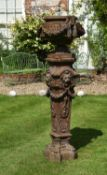 A French cast iron urn on plinth