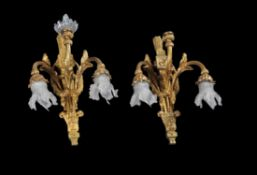 A pair of French gilt brass three light wall brackets in 18th century style