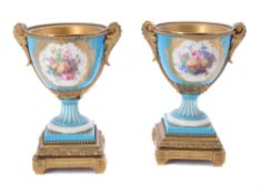 A pair of French porcelain Sevres-style gilt-metal mounted urns