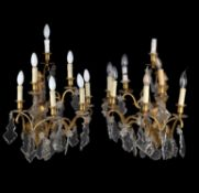 A pair of gilt metal and cut glass six branch wall appliques in Louis XV style