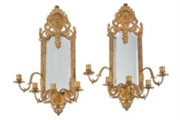 A pair of French gilt metal five light girandoles
