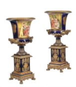 A pair of modern Sevres-style porcelain and gilt metal mounted campana urns and stands