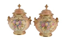 A pair of Royal Worcester ivory-ground pot-pourri urns and covers signed and painted with flowers by