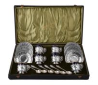 A set of six French silver mounted porcelain coffee cups and saucers by Edouard Ernie