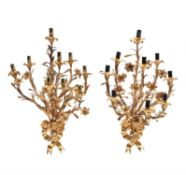 A pair of French gilt metal nine light wall appliques in Louis XV style