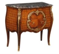 A French mahogany kingwood, parquetry, and gilt metal mounted commode in Louis XV style