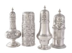 Four silver sugar casters comprising: an ogee baluster by Stokes & Ireland Ltd