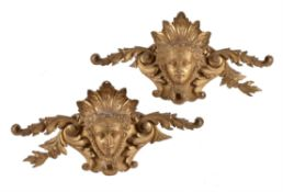 A pair of carved giltwood wall plaques in 18th century style