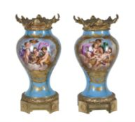 A pair of French porcelain Sevres style gilt-metal mounted inverted baluster vases