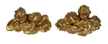 A pair of carved giltwood and gesso groups of cherubs