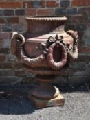 A painted cast iron garden urn by A. Motteau of Buenos Aires