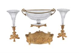 A pair of Napoleon III gilt bronze and clear glass trumpet vases