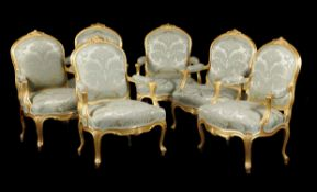 A set of six carved giltwood and upholstered fauteuils in Louis XV style