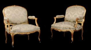 A pair of giltwood and upholstered fauteuils in Louis XV style