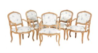 A set of ten carved beech wood elbow chairs