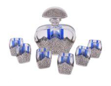 A Bohemian Art Deco blue flash liqueur set with Indian silver mounts
