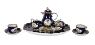 A Meissen ornithological blue-ground and gilt porcelain tête-à-tête coffee service