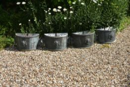 A set of four painted metal planters in 18th Century style