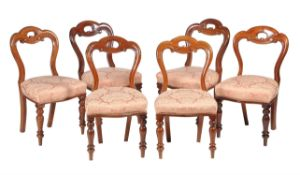 A set of twelve Victorian mahogany dining chairs