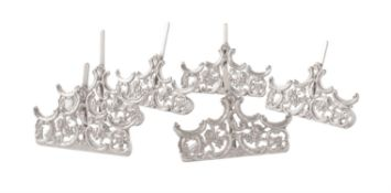 A matched set of six late Victorian and Edwardian silver holders by William Comyns & Sons