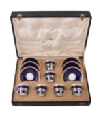 A set of six Edwardian silver coffee cup holders by Mappin & Webb