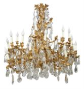A substantial French gilt bronze and cut glass twenty-four light chandelier in Louis XV style