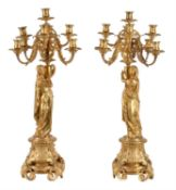 A pair of Napoleon III ormolu nine light figural candelabra