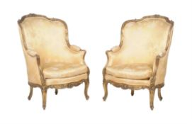 A pair of gilt framed fauteuils in the Louis XVI style