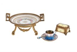 A French porcelain and gilt-metal mounted trinket box and hinged cover