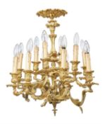 A French gilt bronze twelve light chandelier in Louis XV style