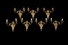 A set of seven French gilt bronze wall appliques in Louis XVI style