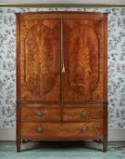 A Regency mahogany and inlaid linen press