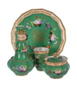 A French porcelain green-ground and gilt solitaire absinthe service painted with flowers